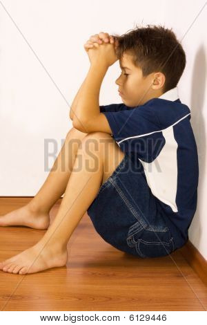 Upset Boy Against A Wall
