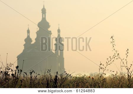 Silhouette of Roman Catholic church on sunrise