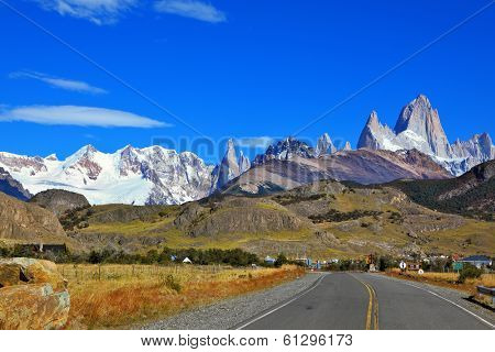 Famous rock Fitz Roy peaks in the Andes. Excellent highway in El Chalten.  Magnificent panorama of snow-capped mountains in Patagonia