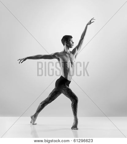 Young, handsome, sporty and athletic ballet dance. Black and white image.