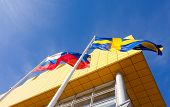 Samara, Russia - March 9, 2014: Flags Of Russia And Sweden Near Ikea Samara Store. Ikea Is The World