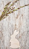 Easter Decoration With Wooden Rabbit And Catkins On Old Wood