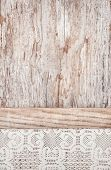 Lacy Fabric On The Old Wooden Background