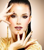 foto of minx  - Portrait of the beautiful fashion woman with black makeup and golden manicure - JPG