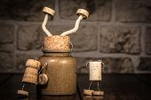 picture of midget  - Concept stucking in a pot with wine cork figures - JPG