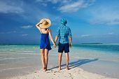 Couple in blue on a tropical beach at Maldives