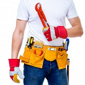 worker with tools belt holding