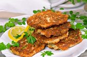 pic of patty-cake  - Vegetable and meat patties on a wooden table - JPG