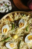 stock photo of raita  - Hyderabad egg biryani is prepared with rice, egg and spices. This can be served with raita.