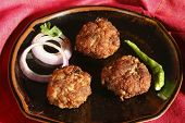foto of kababs  - Kacche Kebab is made by Keema and besan adding egg. Roll the kababs holding the frying pan handle. Fry over moderate heat, till kababs turn brown.Kacche kebab contains keema as major ingredient.
