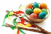 image of flogging  - Czech rod with Easter eggs on white background - JPG