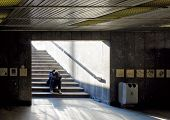 pic of hobo  - Lonely man sitting on stairs - JPG