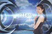 The word client and thoughtful businesswoman against clouds in a futuristic structure