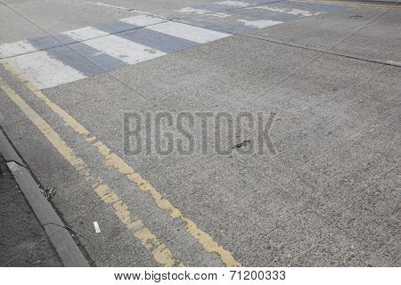 Close-Up of double yellow line on road and Zebra crossing