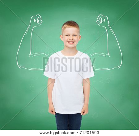 happiness, childhood, school education, advertisement and people concept - smiling little boy in white t-shirt over green board background strong arms drawing
