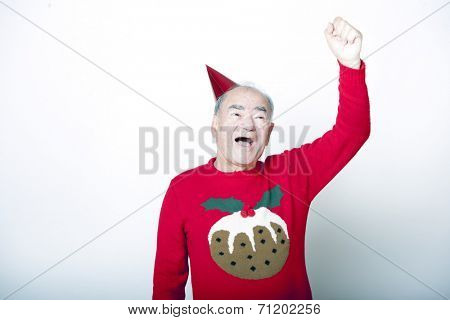 Senior adult man wearing Christmas jumper raising his arm in the air