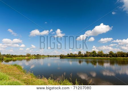 River With Reflection Of Clouds