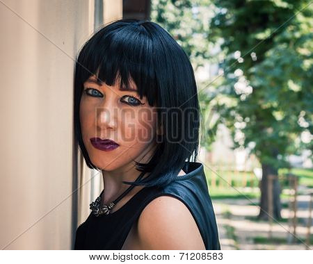 Pretty Goth Girl Posing In A City Park