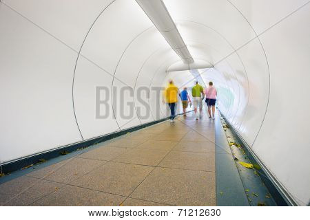 People Go Through Underpass. Abstract Photo From The Center Of Singapore