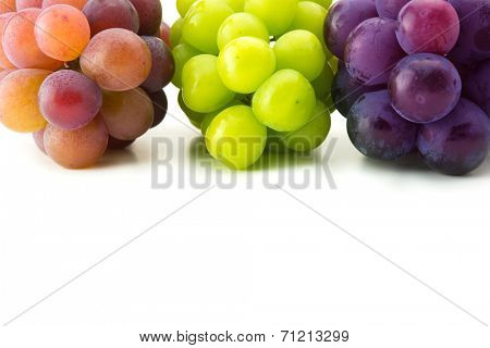 red, black and white (green) grapes on pure white surface.