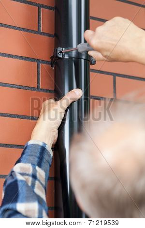 Man With A Screwdriver Screwed Gutter