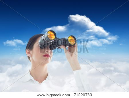 Business woman looking through binoculars against bright blue sky with clouds