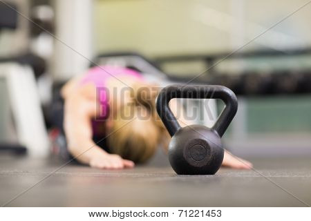Close up of a kettle bell on floor in the gym