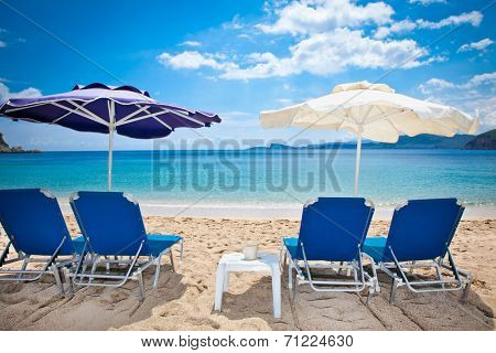 Deckchair on beautiful Lichnos beach near Parga village, Greece.