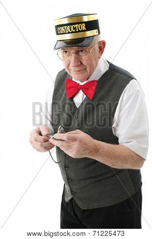 A senior adult conductor holding his pocket watch and looking pleased that the train is coming right on time.  On a white background.