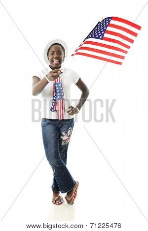 A happy tween girl waving an American flag while showing off her stars and stripes.  On a white background.