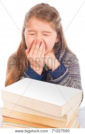 Cute Little Girl Yawning In Front Of Books