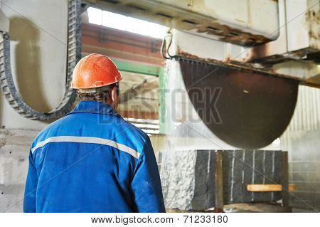 industrial worker at factory on granite or marble manufacture