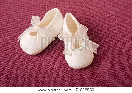 pink baby booties detail