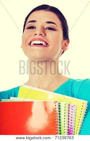 Portrait of a young beautiful female student with workbook. Isolated on white.