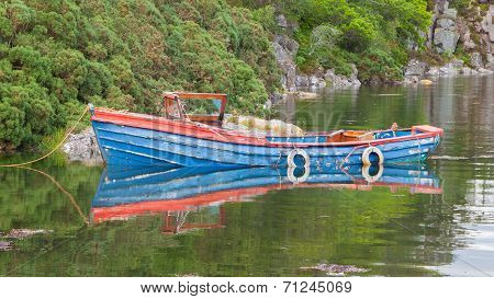 Small Rowboat On A Lake