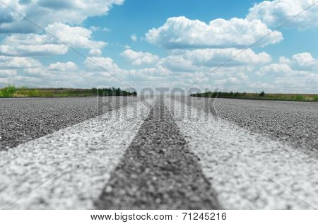 two solid white lines on asphalt road. soft focus on road