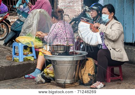 women selling Vietnamese Sandwich with Grilled Pork