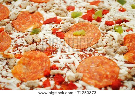 Background Of A Pizza Of Pepperoni, Cheese, And Peppers