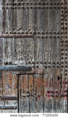 Ancient wooden door with wood studs