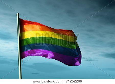 Rainbow Flag Waving On The Wind