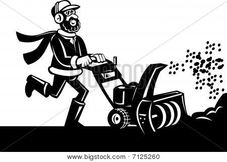 Man operating snow blower or snow thrower