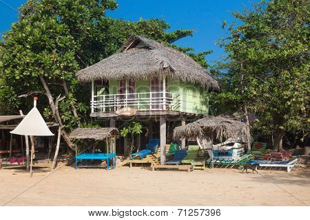 WELIGAMA, SRI LANKA - MARCH 8, 2014: Small Bungalow on beach. Weligama is  one of most popular Sri Lankan beaches.