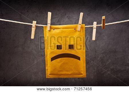 Sad Face Emoticon On Mail Envelope