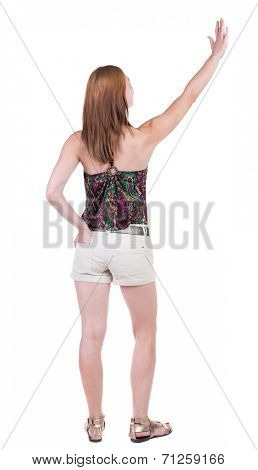 Back view of beautiful woman welcomes. Young teenager girl in shorts hand waving from. Rear view  people collection.  backside view of person.  Isolated over white background.