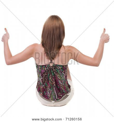 back view of siting young blonde  woman showing thumb up.  Rear view people collection.  backside view of person.  Isolated over white background