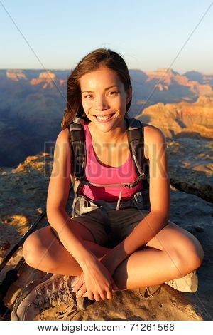 Hiking woman smiling natural candid in happy outdoor portrait. Aspiration lifestyle image of hiker young multiracial female hiker in Grand Canyon, South Rim, Arizona, USA.