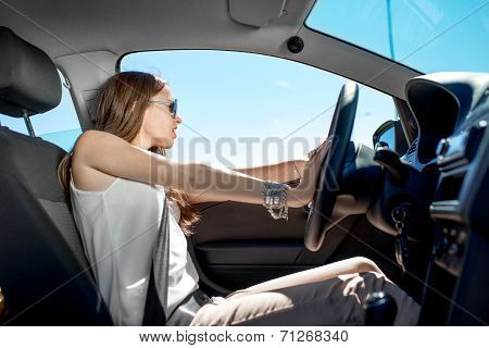 Young Elegant Woman Stopping The Car And Screaming