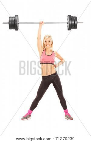 Full length portrait of a strong woman lifting a weight with one hand isolated on white background