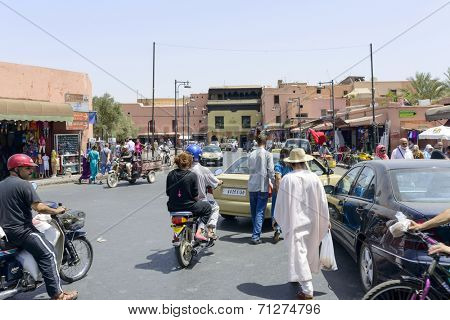 MARRAKESH, MAROCCO - AUGUST 24: Tourists visiting Marrakesh's medina quarter on 24 August 2014 in Marrakesh, Morocco.