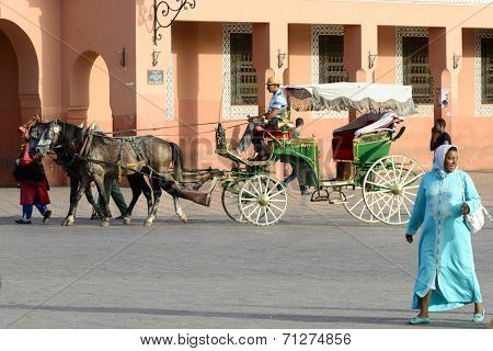 MARRAKESH, MAROCCO - AUGUST 24: Coachman waiting for tourists on the market place in Marrakesh's medina quarter on 24 August 2014 in Marrakesh, Morocco. Djemaa el Fna is a UNESCO world heritage site.